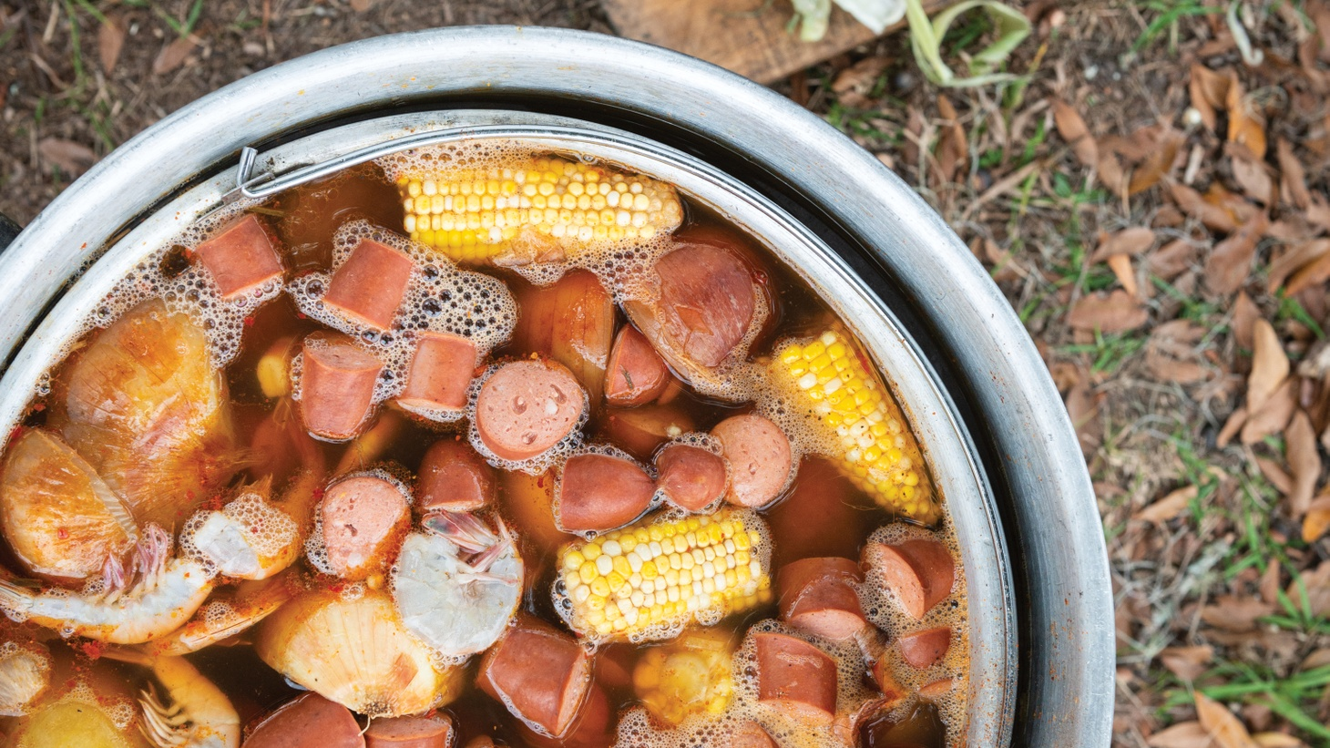 Chef Matthew Raiford adds Wainwright's smoked sausage and blue crabs to his lowcountry boil.