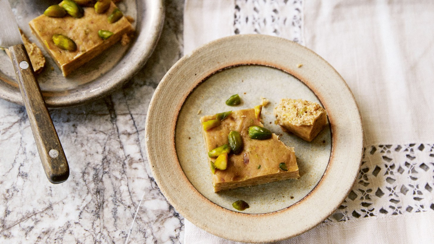 "Friday Mosque Halva from ""Red Sands"" by Caroline Eden includes nubs of dried fruit, creamy white chocolate and neon green pistachios. It's an ideal teatime treat."