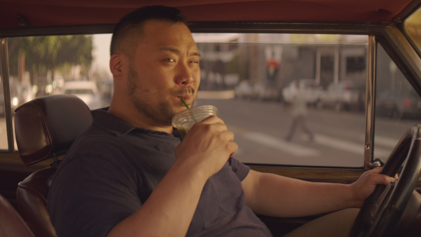 "David Chang driving around the streets of Los Angeles in ""Breakfast, Lunch, & Dinner."""