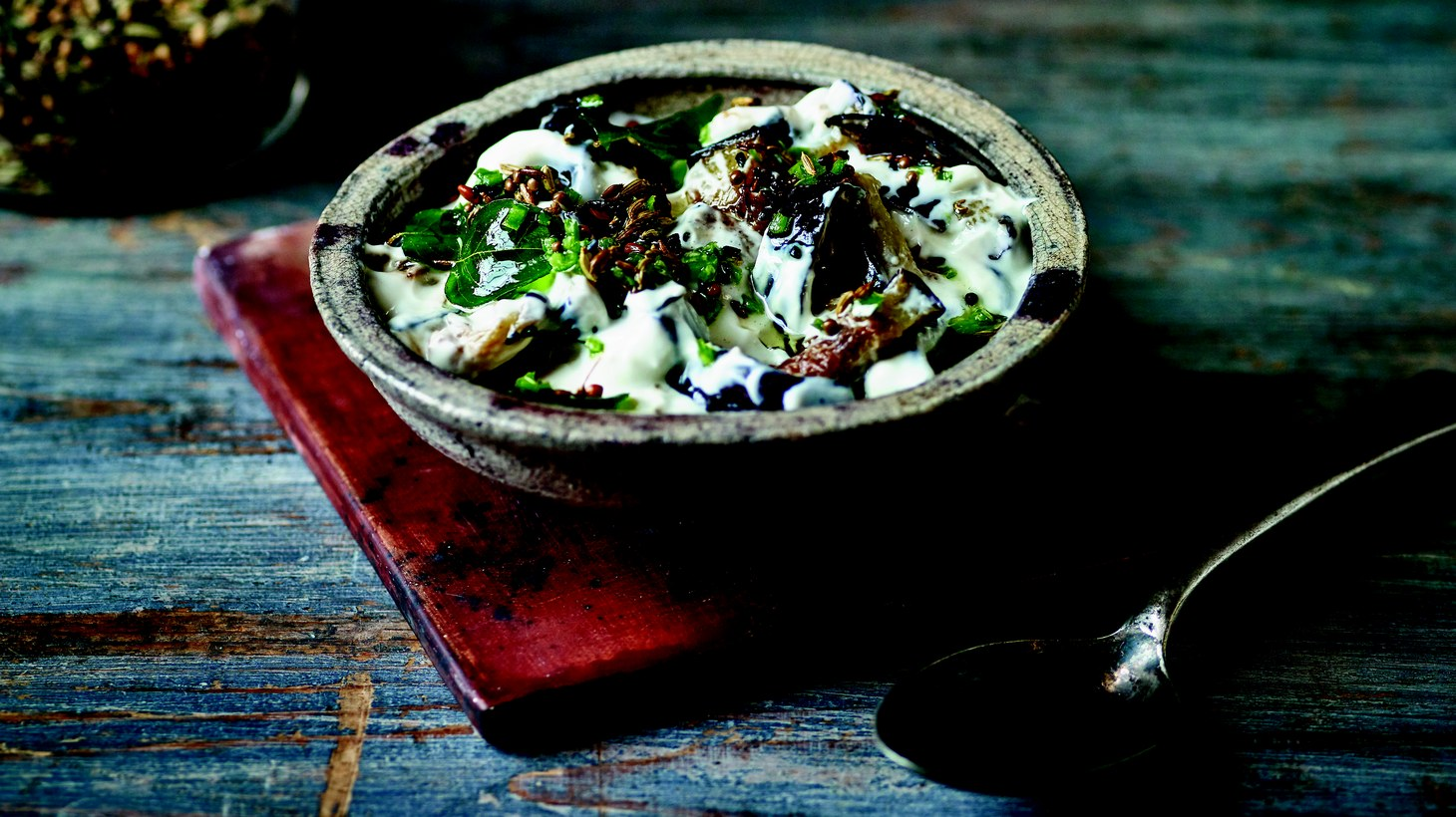 Baking rather than frying is Chetna Makan's preferred method of cooking eggplant to keep her raita dish healthy.
