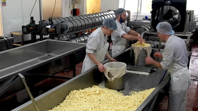 Cheddar production at Montgomery Cheese in Somerset, England.