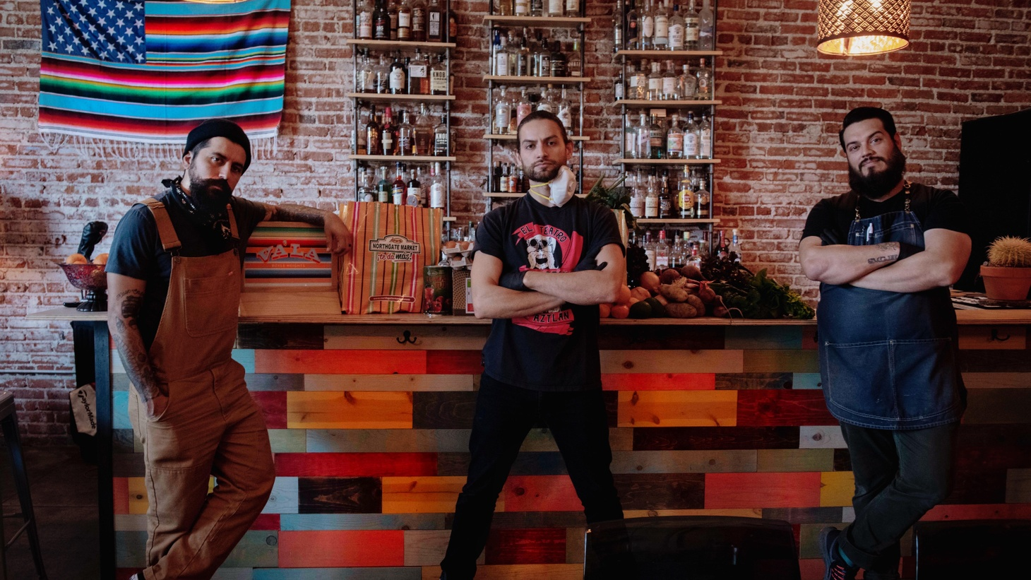 "From left to right: Aaron Melendrez, Damian Diaz, and Othón Nolasco of Va'La Hospitality, a bar consulting group based in Boyle Heights. They are the men behind ""No Us Without You,"" an initiative that's now assisting 200 families on a weekly basis."