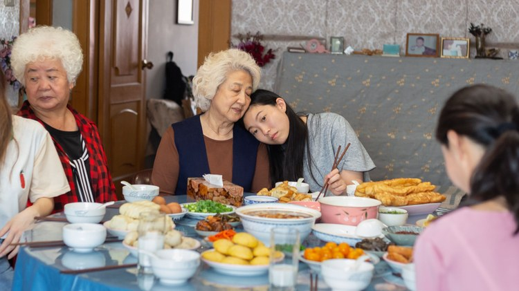 """Throughout Lulu Wang's movie """" The Farewell ,"""" a Chinese family gathers around the dinner table. They've come together for a wedding banquet, though it's a ruse."""