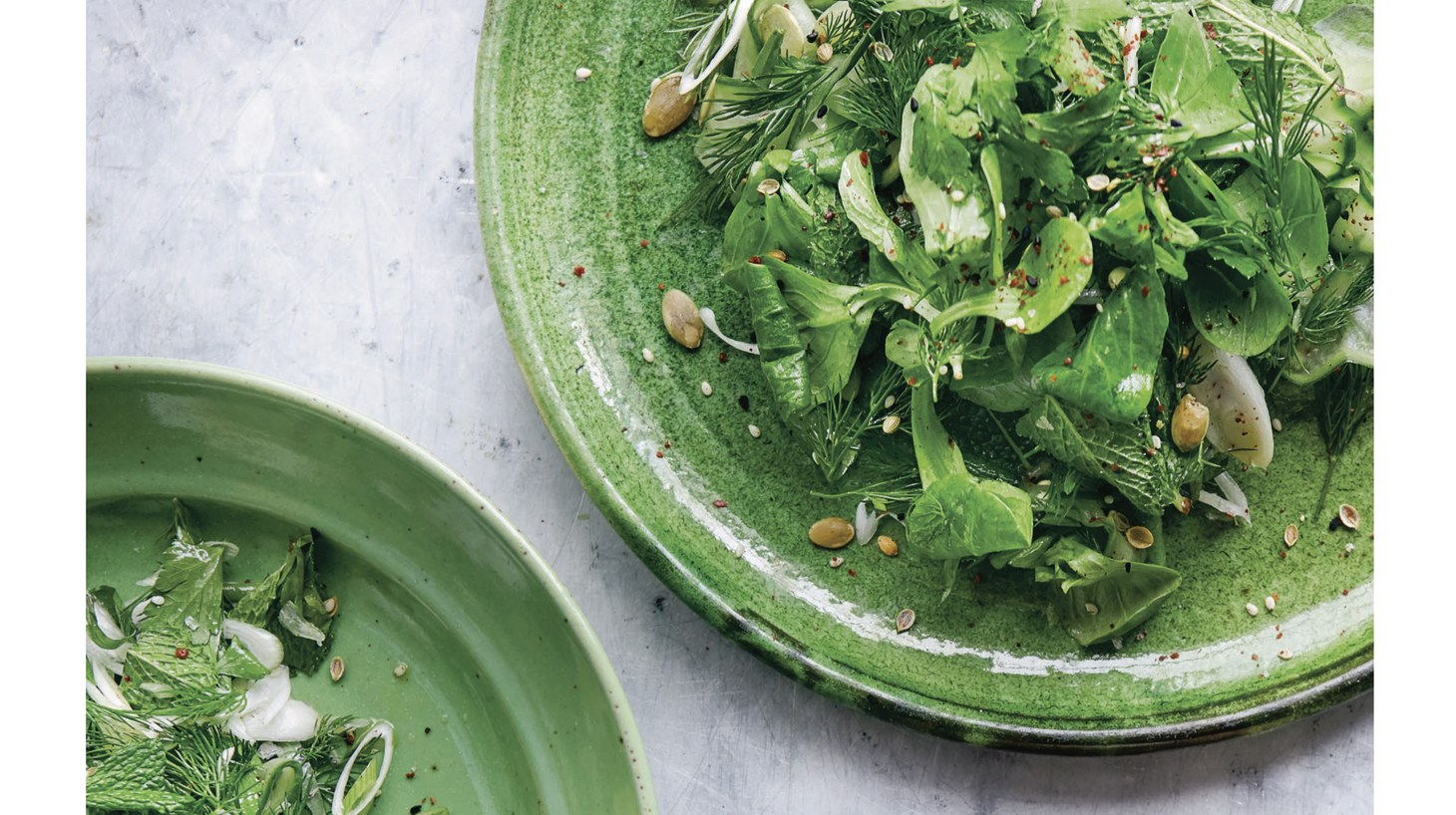 Chef Sami Tamimi suggests Spicy Herb Salad with Pickled Cucumbers to accompany grilled dishes this summer.