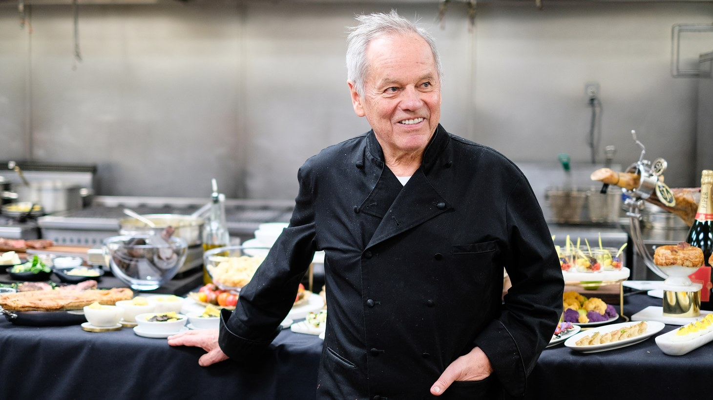 Chef Wolfgang Puck in front of his 25th Governors Ball spread at Wolfgang Puck Catering Kitchen in Hollywood.