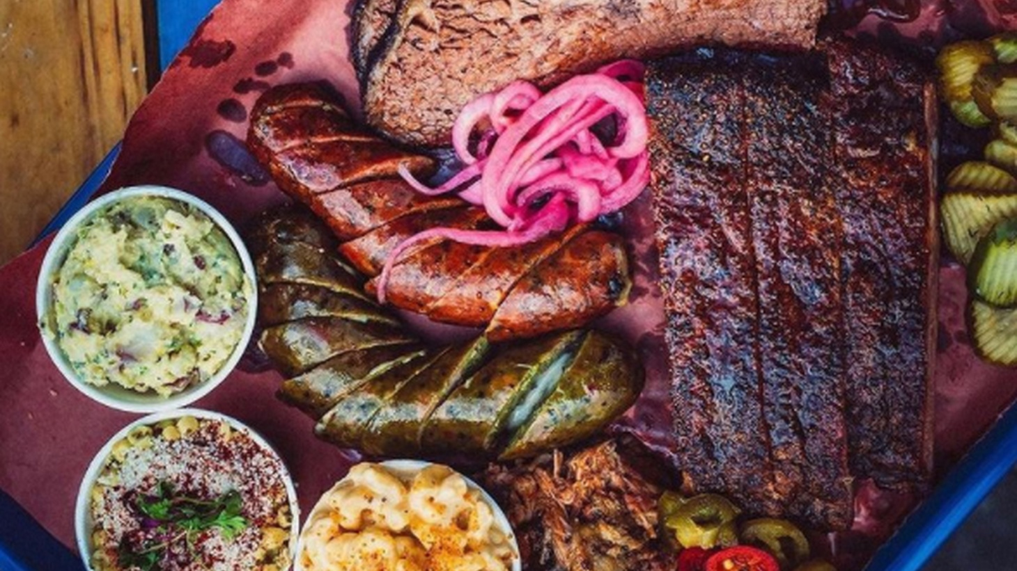 Andrew Munoz of Moo's Craft Barbecue is serving up Texas-style barbecue with the trinity of brisket, sausages, and ribs.