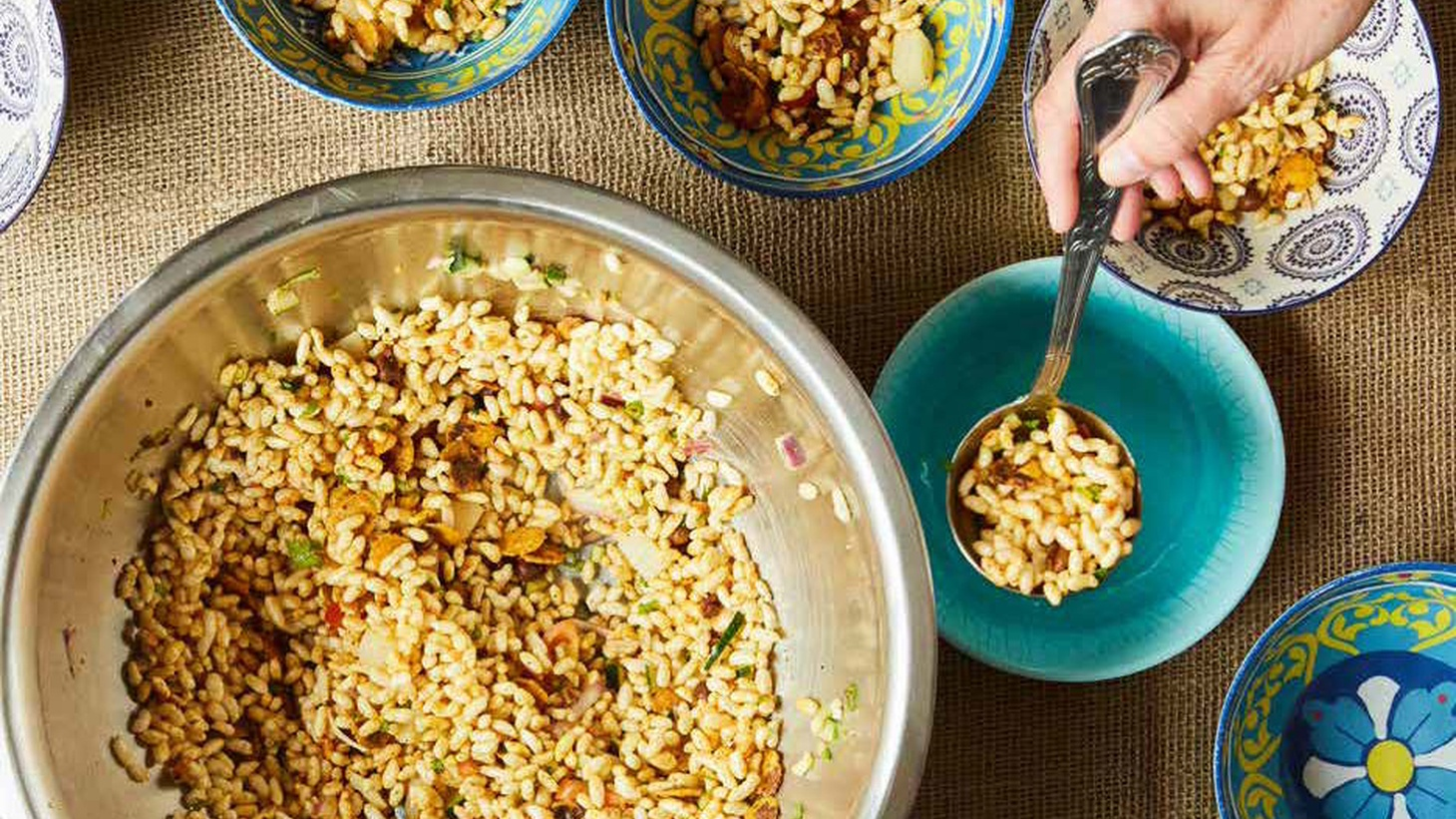 """Jhal muri, a spicy puffed rice, is one of Kolkata's most popular street food snacks. Jhal means """"spicy"""" and muri means """"puffed rice,"""" but according to chef Maneet Chauhan, the dish is much more than that."""