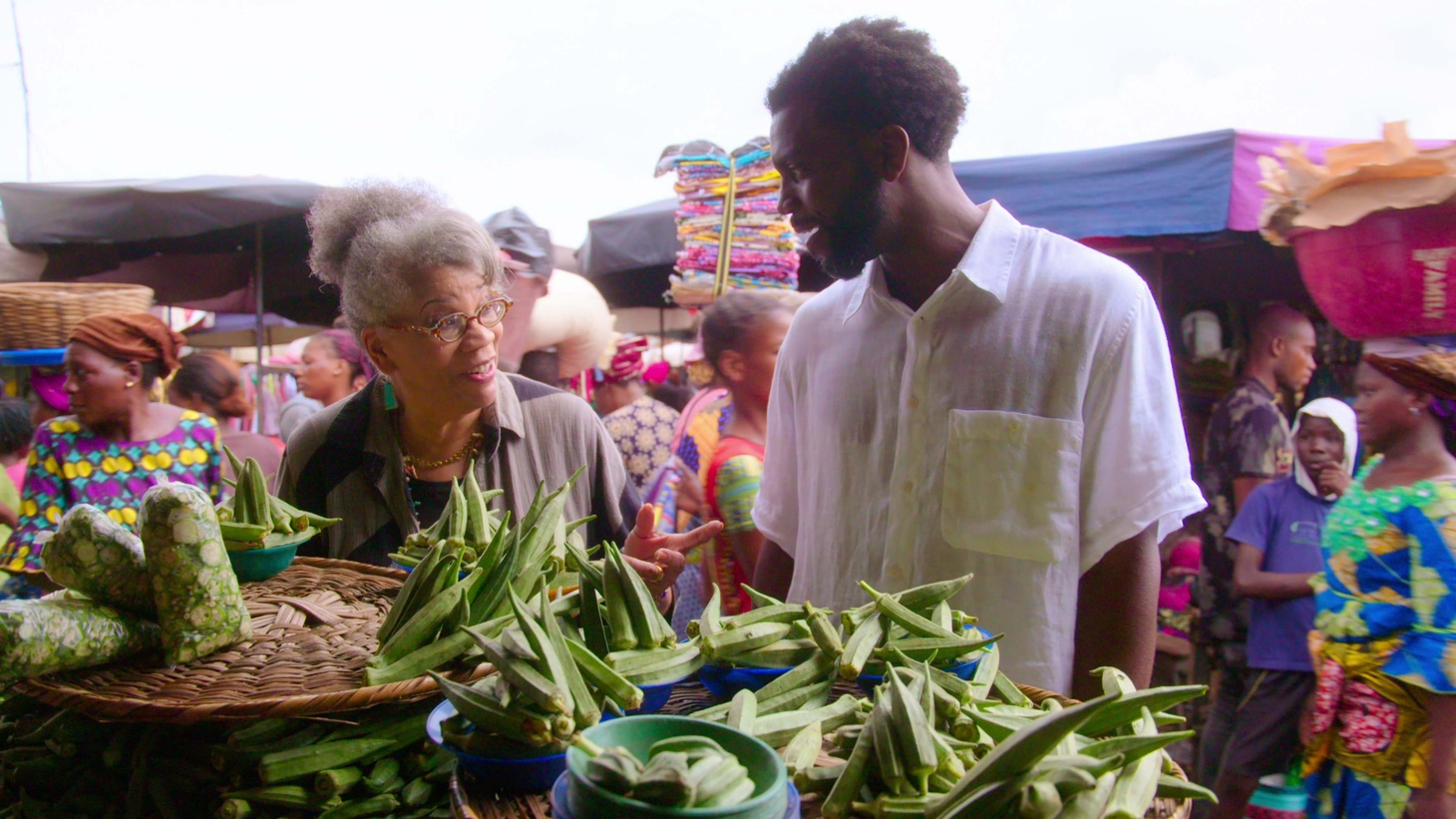 """Jessica B. Harris guides Stephen Satterfield through the market in Benin in the first episode of """"High on the Hog,"""" an adaptation of her book by the same name."""