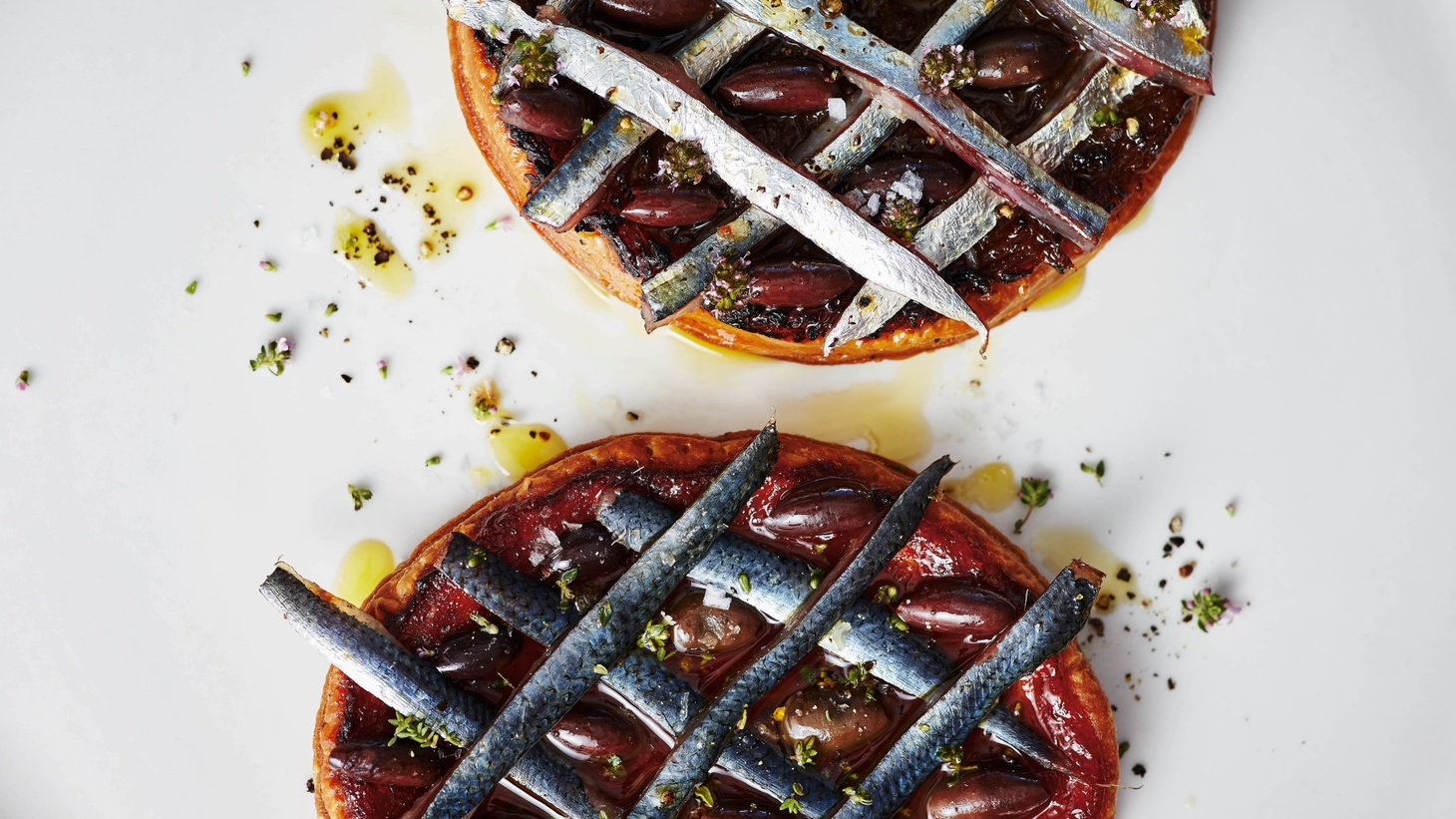 Josh Niland uses his experience working in a French restaurant in Sydney to create a pissaladiere in which he substitutes latticed sardines for anchovies to tame the salf-forward dish.