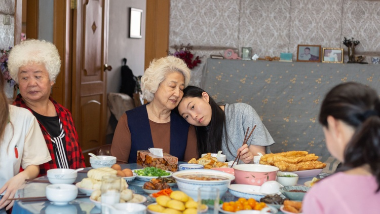 """At various points in director Lulu Wang's movie """"The Farewell,"""" a Chinese family is shown interacting around the dinner table."""