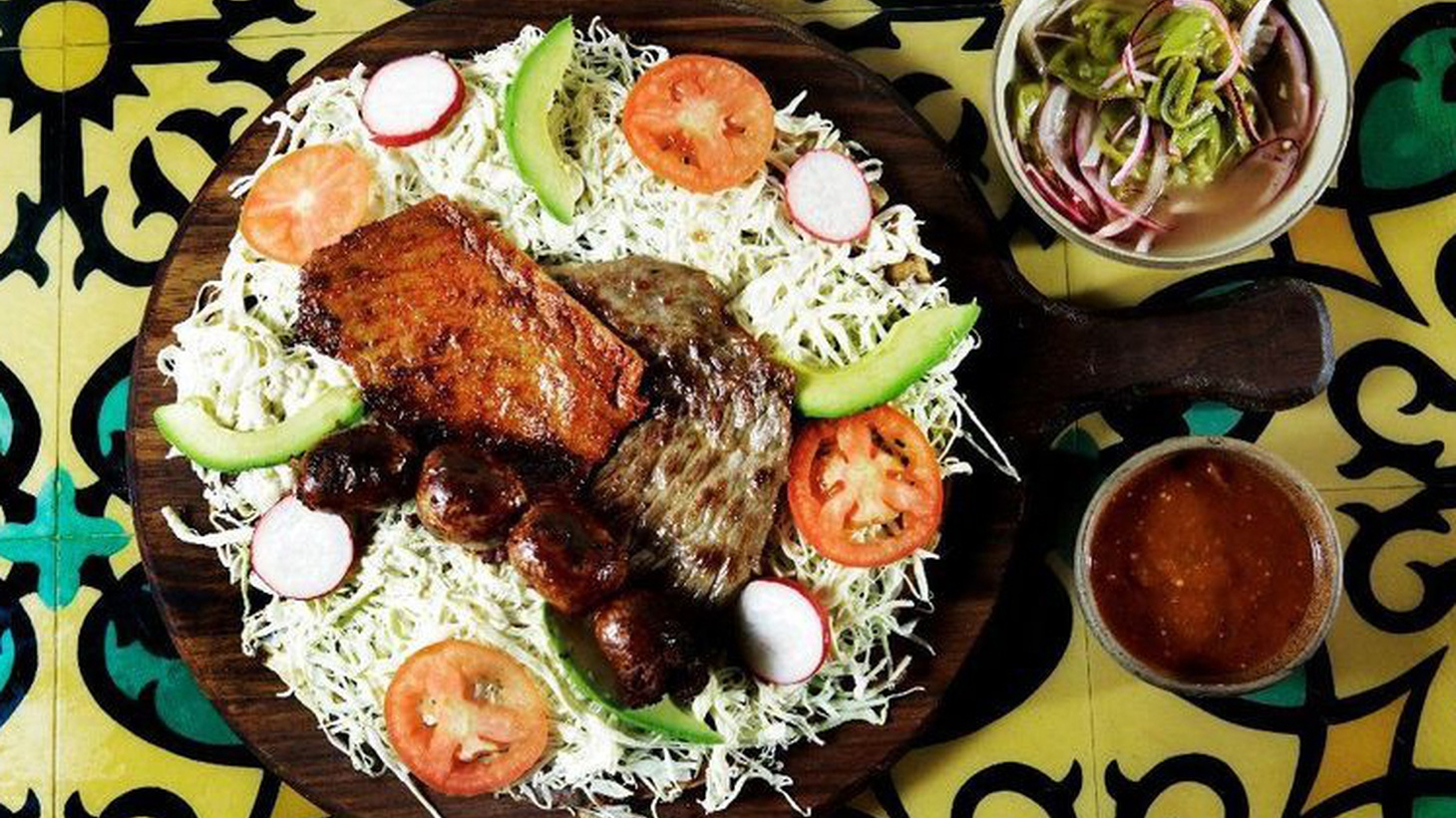 Tlayuda is among the Oaxacan classics on Madre's menu.