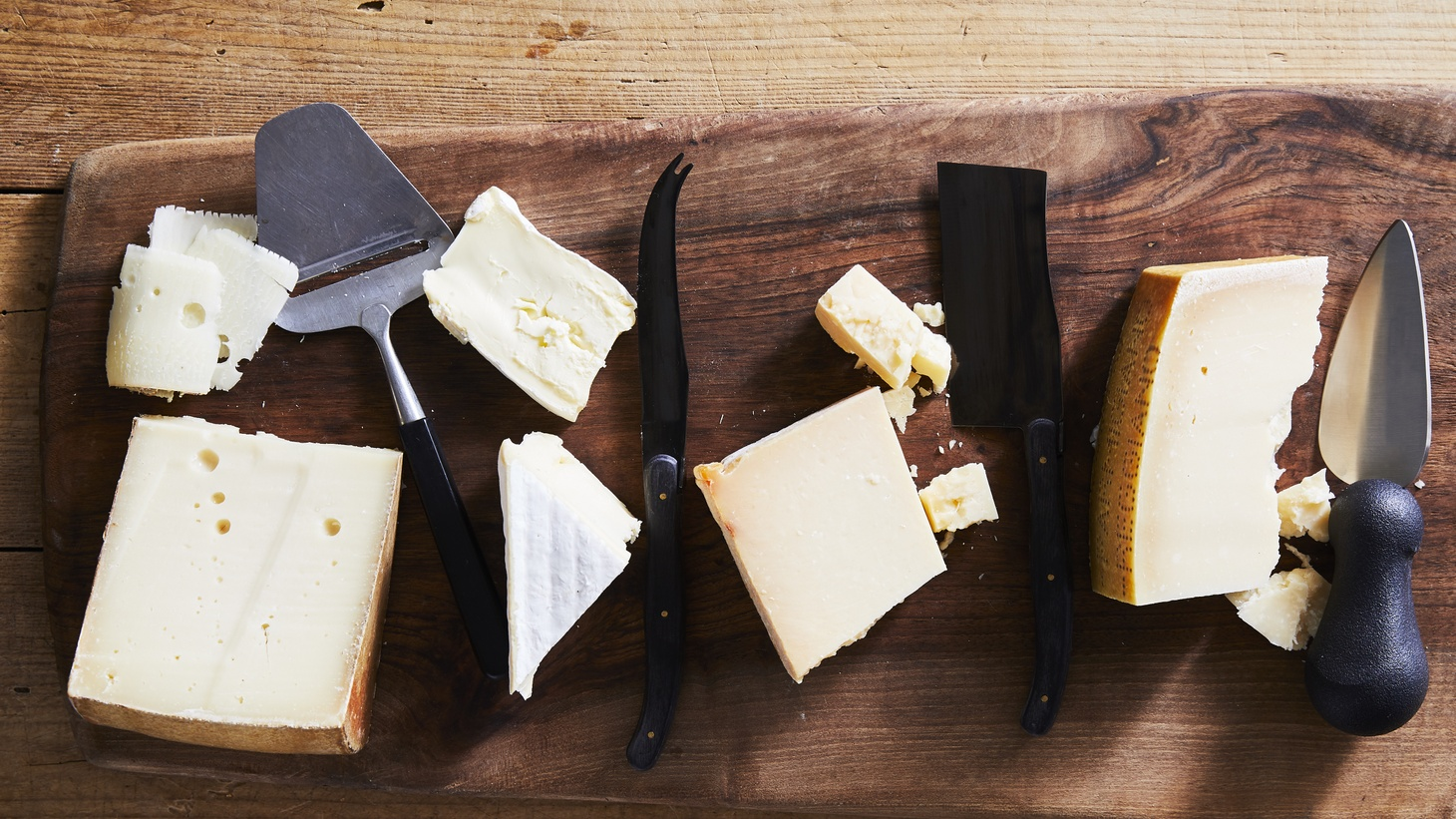A cheese board and knives.
