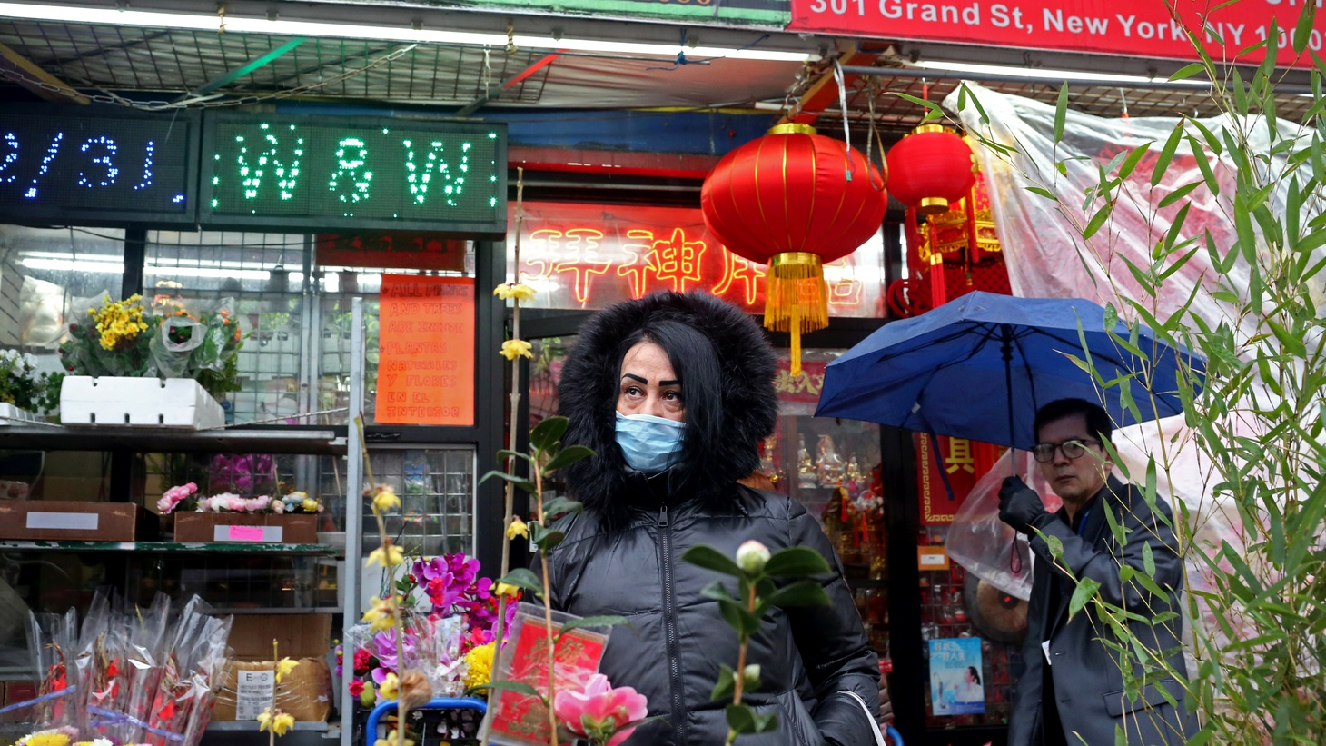 A woman who prefers to remain anonymous poses for a picture in Chinatown in New York, U.S., February 13, 2020. Originally from Kazakhstan, she said she's lived in New York for two years, and that she wears a mask because she has five children and is afraid of coronavirus transmission.