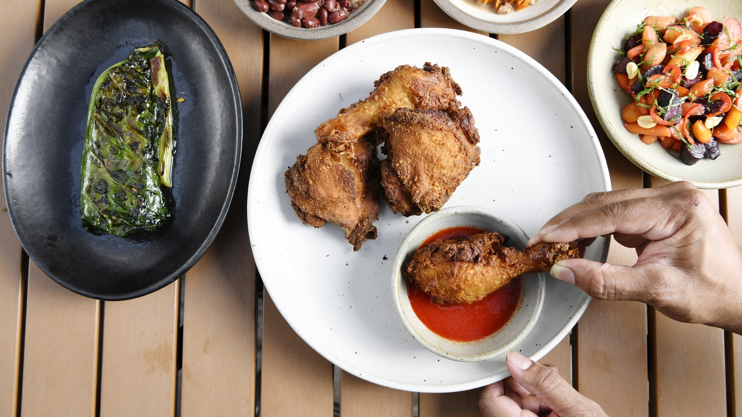 Alta Adams Fried Chicken with collards and other side dishes.