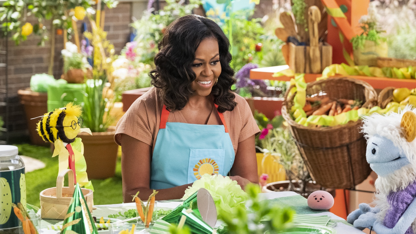 """Michelle Obama acted as a producer and is featured as """"Mrs. O"""" on the Netflix series, """"Waffles + Mochi,"""" imparting life lessons to the puppets upon returning from their global culinary escapades."""