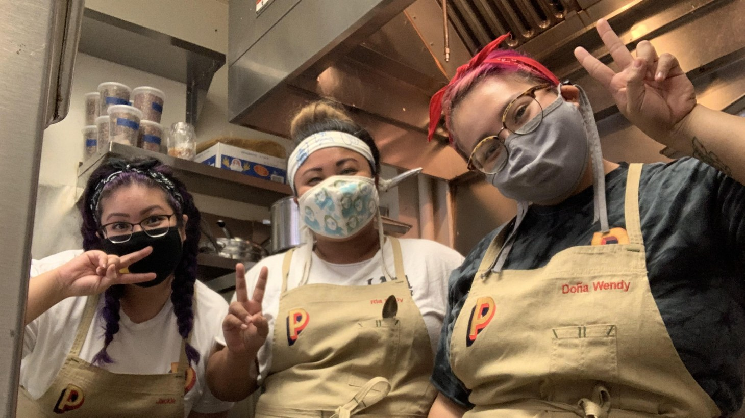 Ria Dolly Barbosa (center) and her team work in a 500 square foot space, turning out Filipino food with a modern twist at Petite Peso.