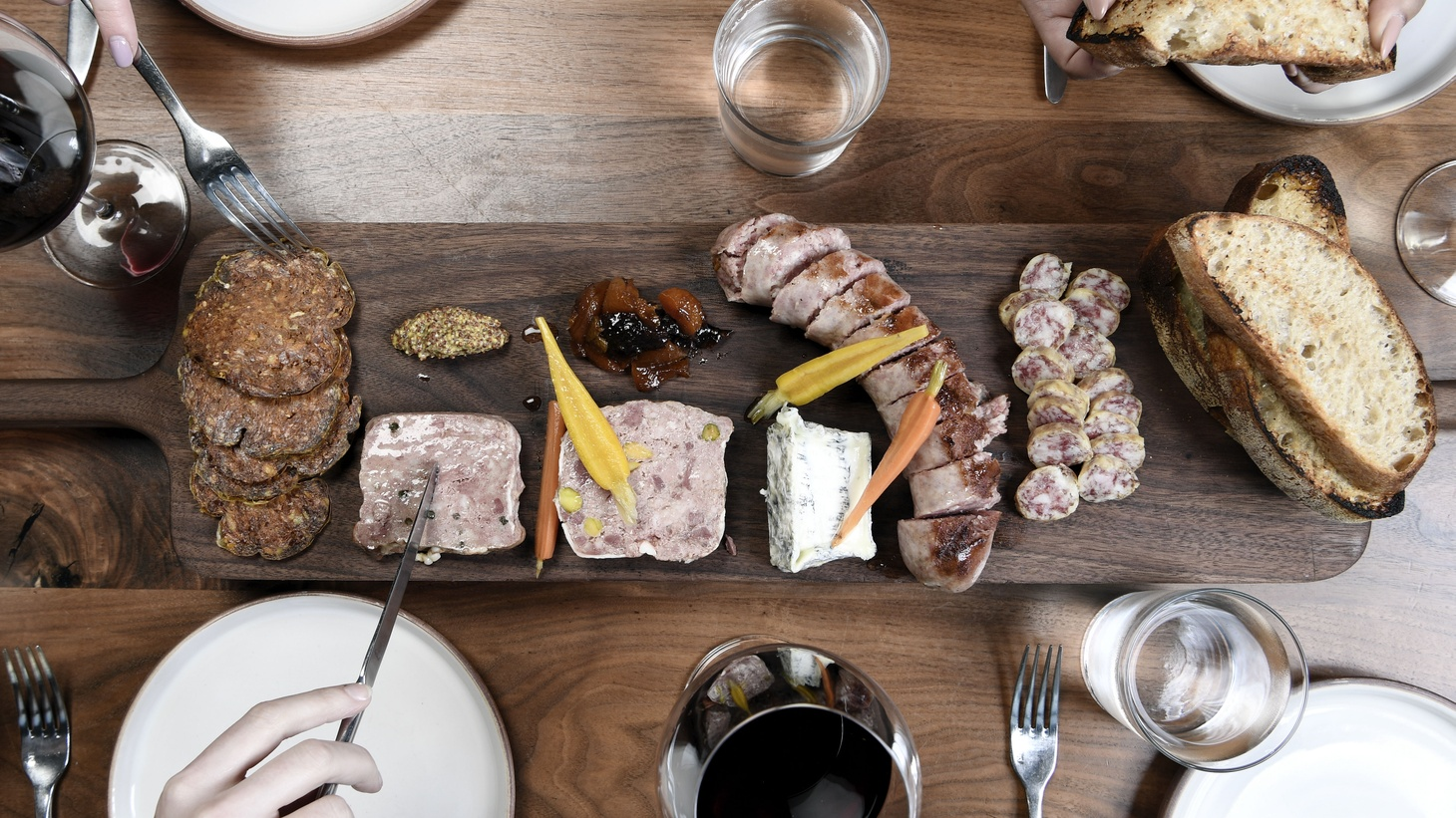 """A mixed selection from the """"delicatesse"""" includes poultry and fresh peppercorn, duck pate smoked bourbon, goat cheese and ash, fermented sausage from Lyon, dry Muscadet sausage and 9 month aged chorizo."""