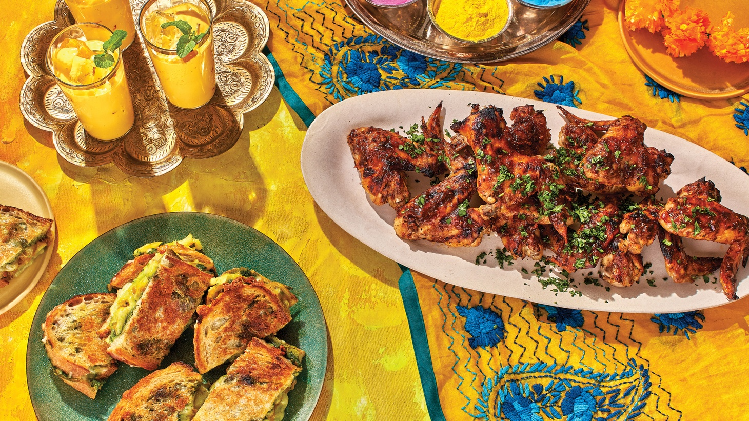 Sweet and Salty Mango Lassi, Burnt Masala Wings, and Bombay Sandwiches — Bon Appétit executive editor Sonia Chopra shares memories of Holi with recipes to celebrate at home.