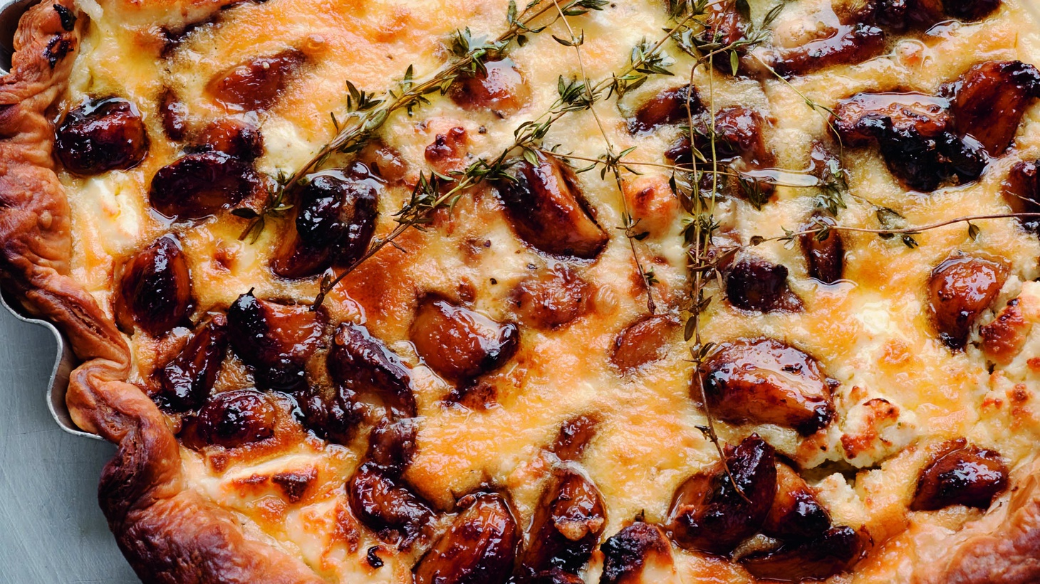 Yotam Ottolenghi owns a number of casual dining restaurants in London. He shares his recipe for a Carmelized Garlic tart.