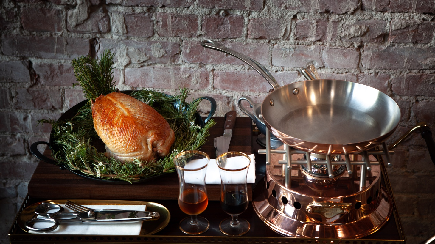 New rules ban tableside service, part of the spectacle of the pressed duck at Pasjoli.