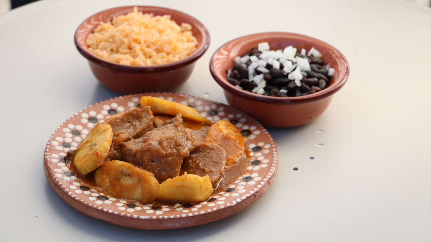 Lengua con plátanos is one of the many regional dishes served by Chef Maria Elena Lorenzo at Tamales Elena in Bell Gardens.