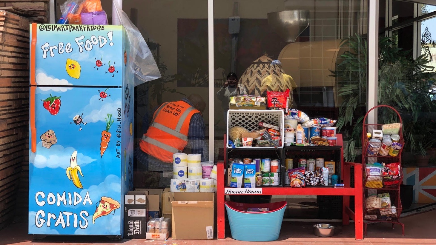Pantry staples, prepared meals, and masks are a few items available at this Mid City community refrigerator.