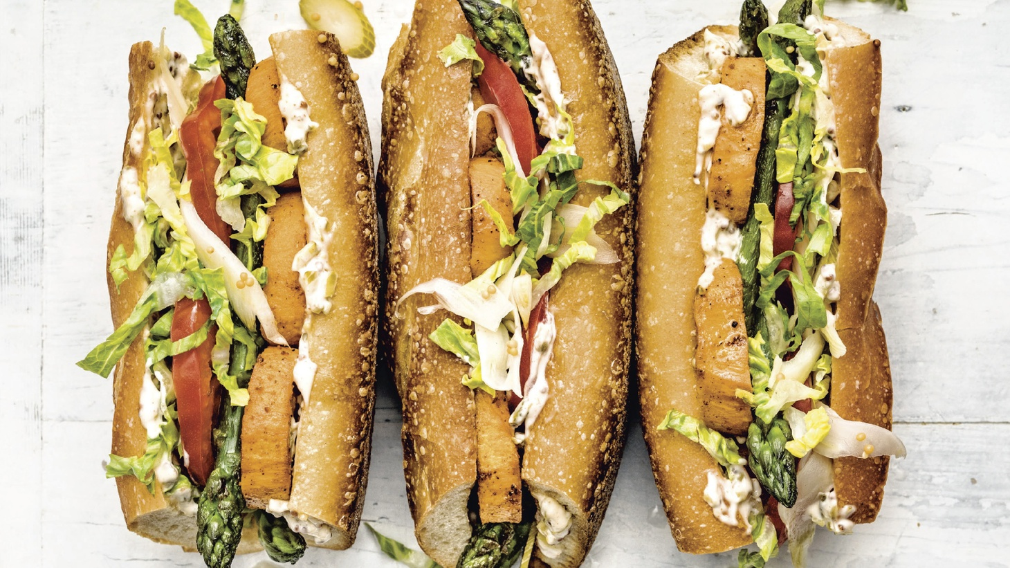 "Kauffman suggests Bryan Terry's Roasted Sweet Potato and Asparagus Po'Boy from ""Vegetable Kingdom."""