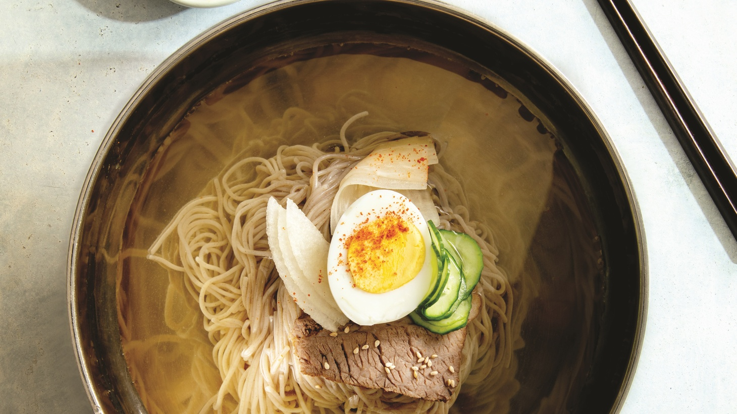 Hooni Kim says that Koreans don't like to line up for food, but when they do it's for the North Korean dish, mul naengmyeon.