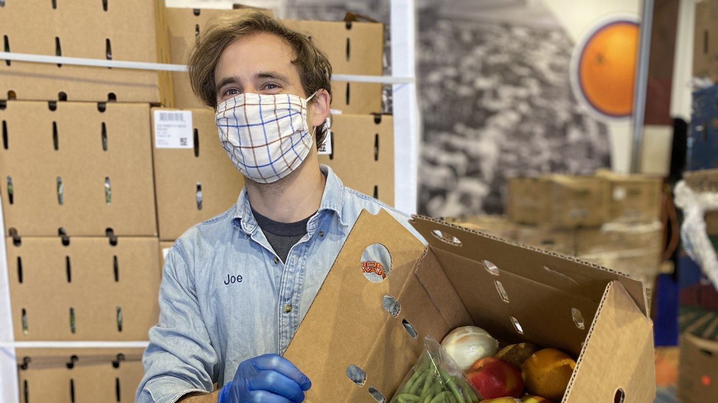 Staff member Joe helps get USDA boxes at Food Forward's Produce Pit Stop.