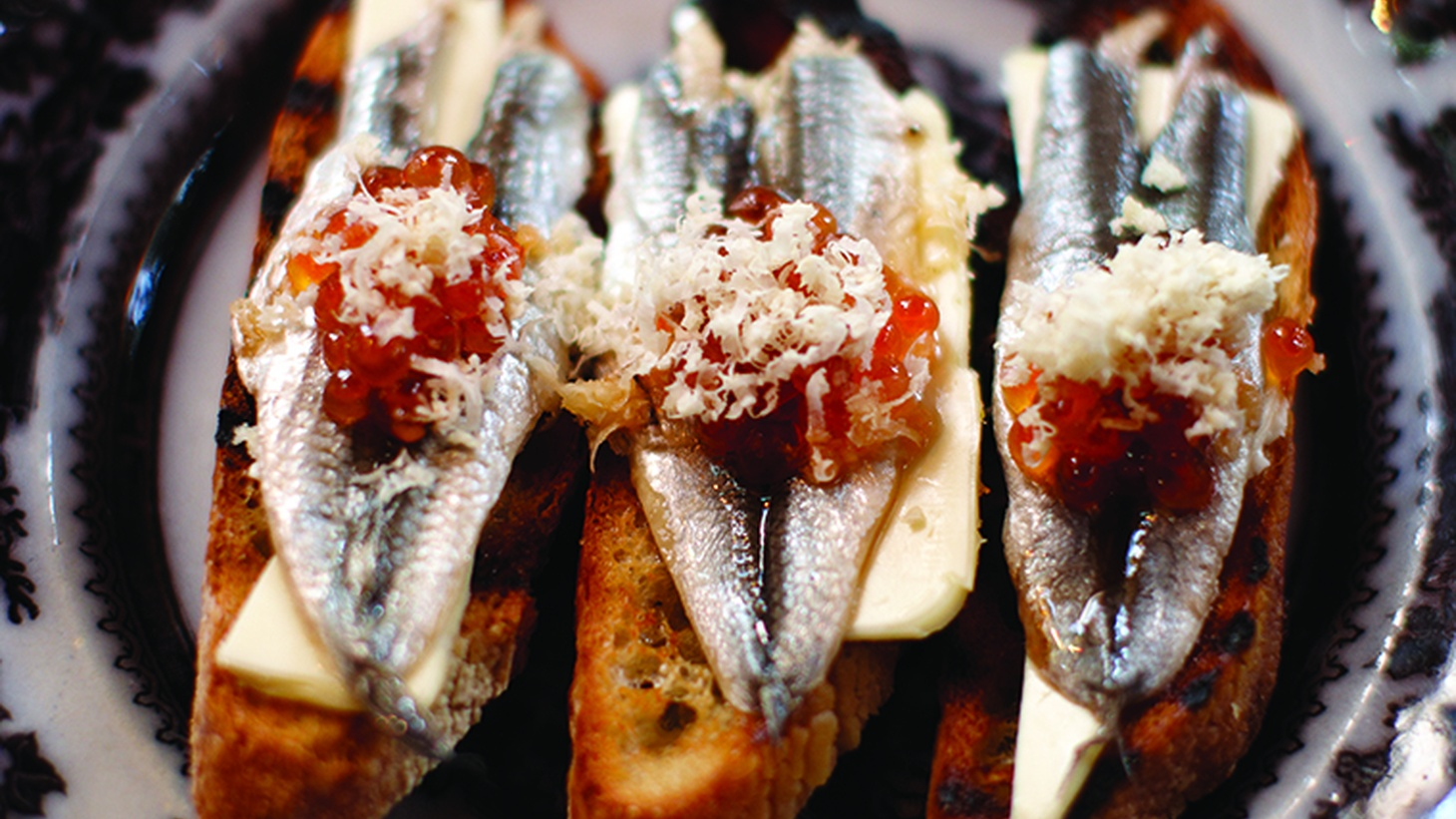Most American and Italian anchovies are cooked and packed in oil. Boquerones, Spanish white anchovies, are usually vinegar-pickled before an olive oil bath and have a mild, tangy flavor.