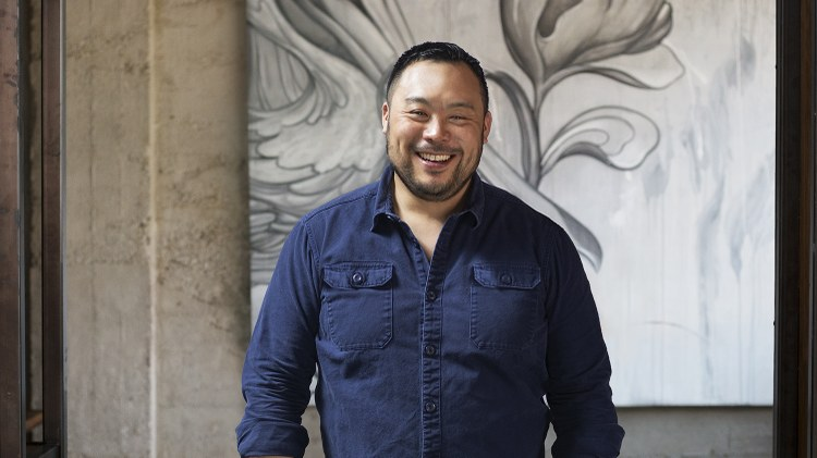 David Chang is seated as co-host for the annual Thanksgiving show