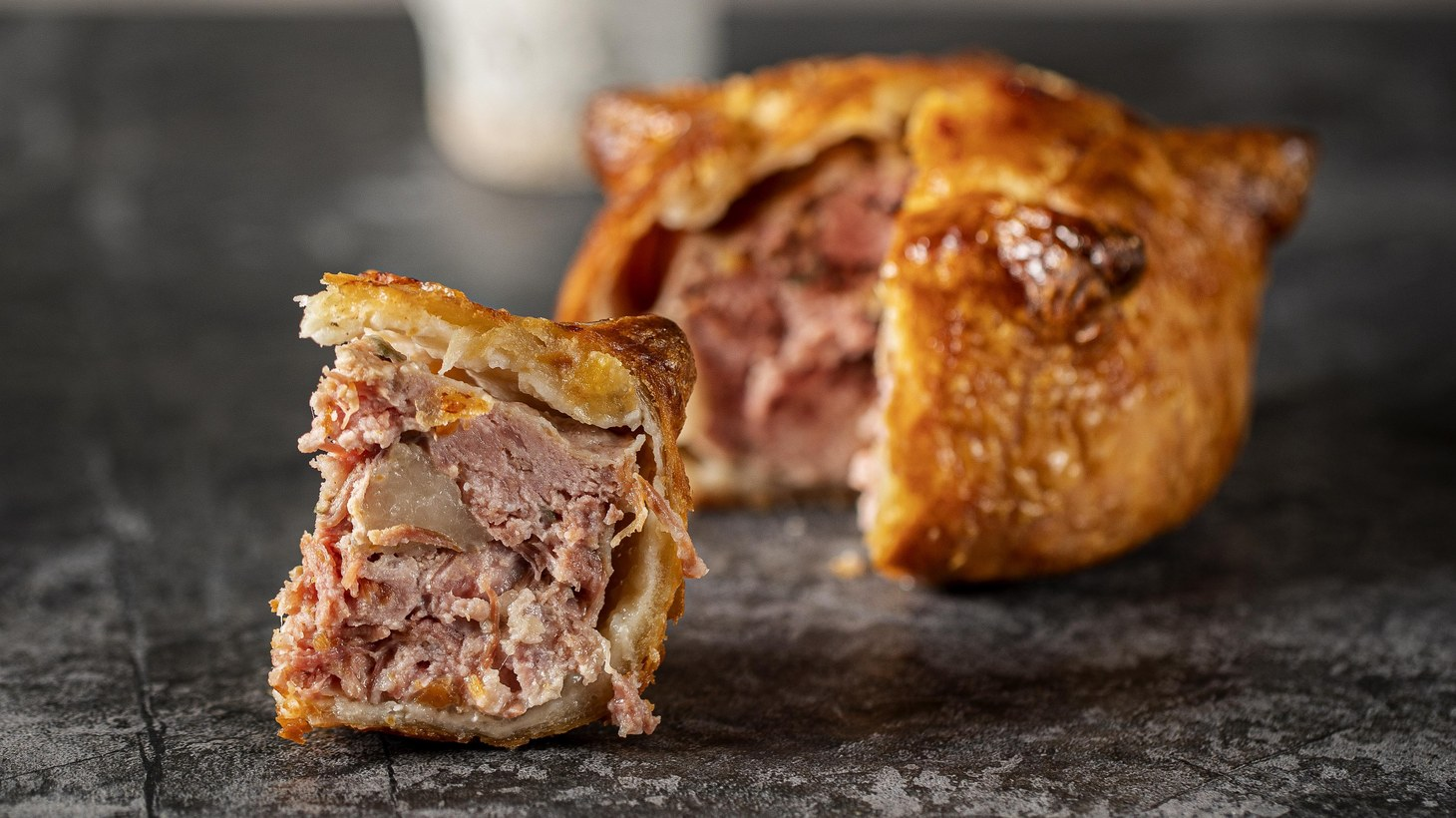 The Pie Room in London has been serving individual pies from a window during the pandemic, including this pork pie which co-host David Chang jokes is the accompaniment to any salad he will eat.