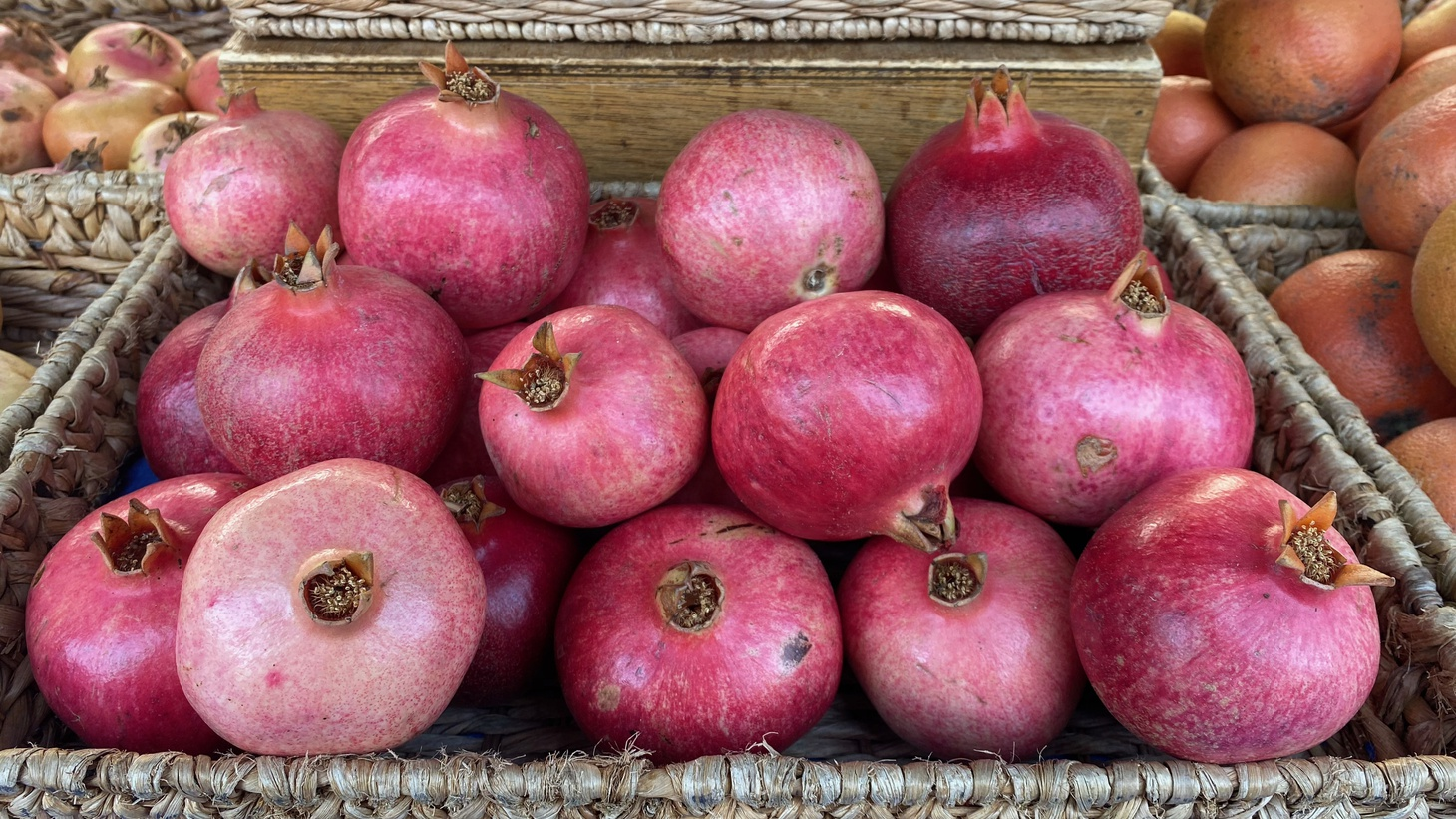 Laura Ramierz of JJ's Lone Daughter Ranch has red and pink varieties of pomegranates, which she suggests using in fizzy cocktails.