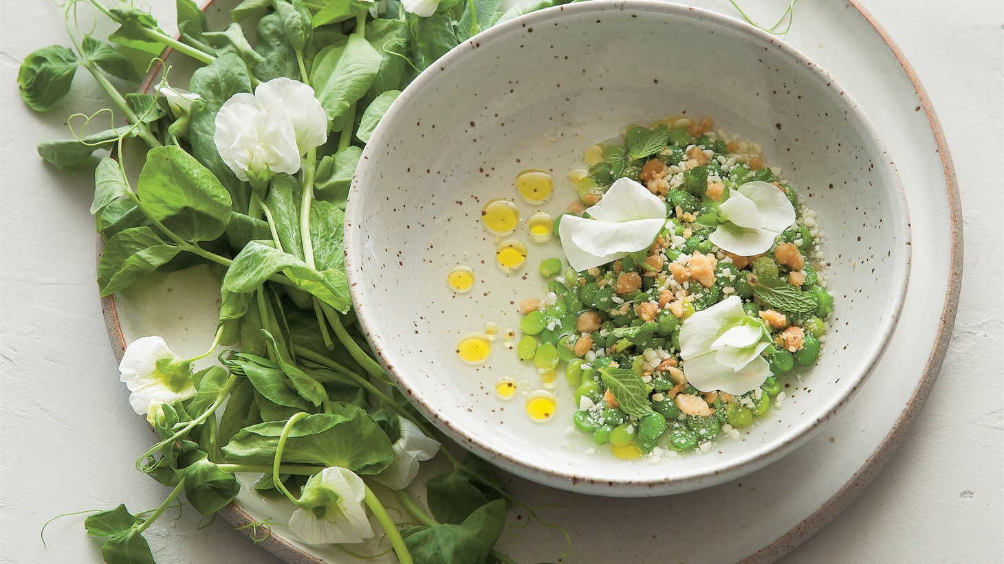 """Chef Jeremy Fox turns vegetables into true expressions of seasonal flavors at Rustic Canyon, Julia Sherman documents artists making salads in """"Salad for President,"""" and Deborah Madison shares meatless meal tips. Then Laura Avery shops for spring veggies at the market while we get a peek at Stacy Michelson's design for KCRW's """"Good Food"""" tote bag. Plus: Jonathan Gold digs into the Redneck Platter at Manuela."""
