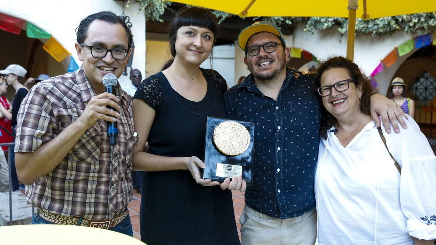 Gustavo Arellano with 2018 winners Sonoratown's Jen and Teo Rodriguez, and Evan Kleiman pose with the Golden Tortilla.