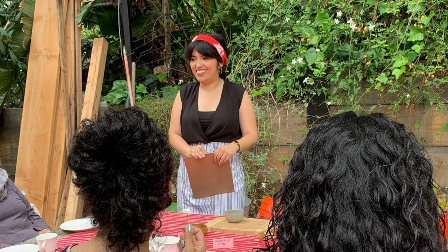 Food writer Karla Vasquez (center) hosts discussion during a cooking workshop on Salvadoran quesadilla.