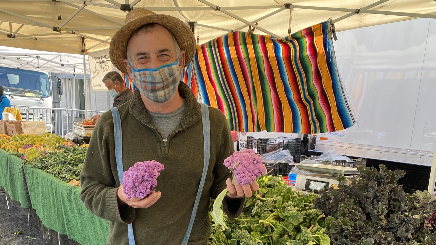 Alex Weiser and his family have been growing crops for 40 years. He recognizes that beyond the produce, people come to the farmer's market to socialize.