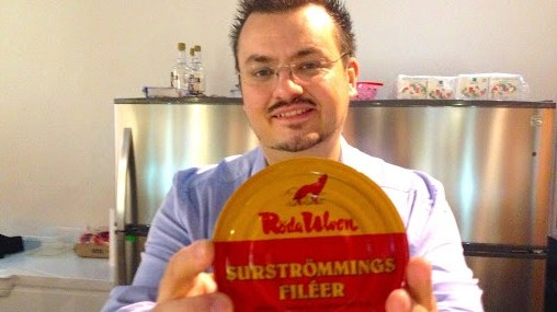 Andreas Ahrens, co-founder of the Disgusting Food Museum, displays a tin of fermented herring, a traditional Swedish delicacy. To some, merely a rotten fish.