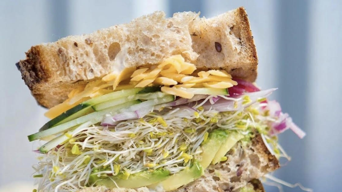 """The """"Ira Glass"""" sandwich at Wax Paper comes on seeded wheat bread with avocado and sprouts."""
