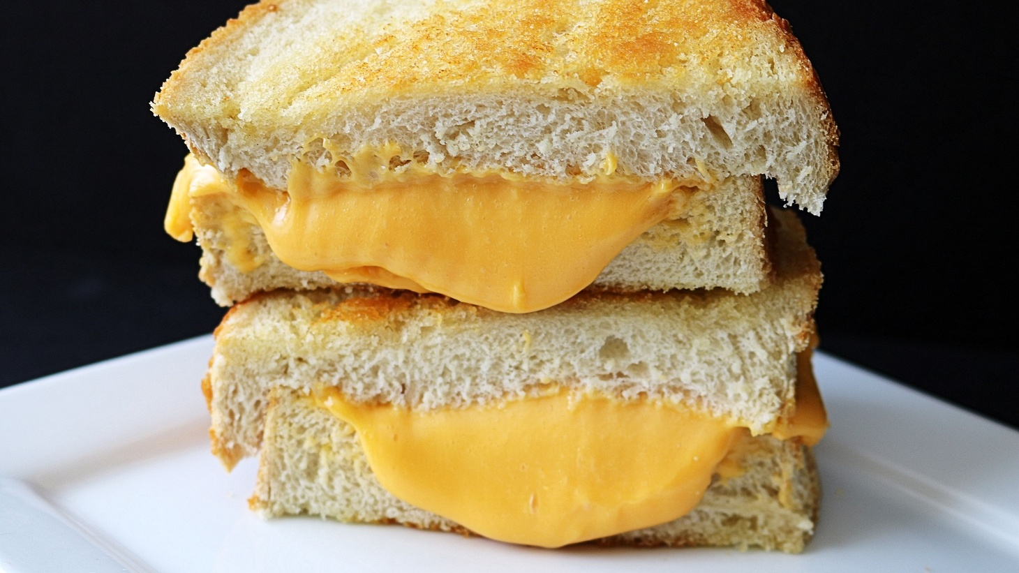 With dueling origin stories, the grilled cheese may have started in Britain with an open-faced, broiled version.