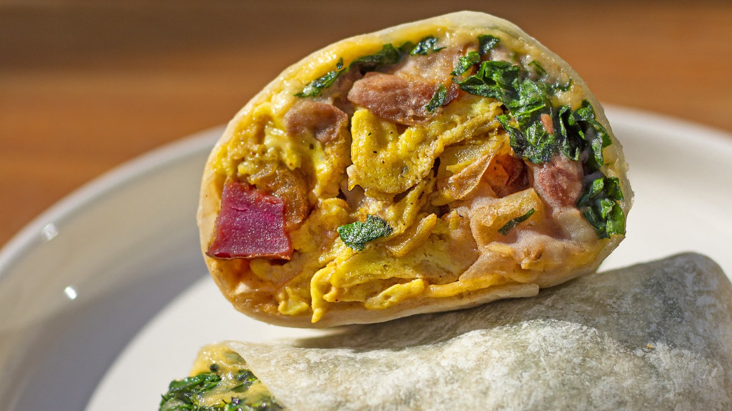 Salima Saunders uses peewee potatoes from Weiser Family Farms in her breakfast burrito at Uplifters Kitchen.