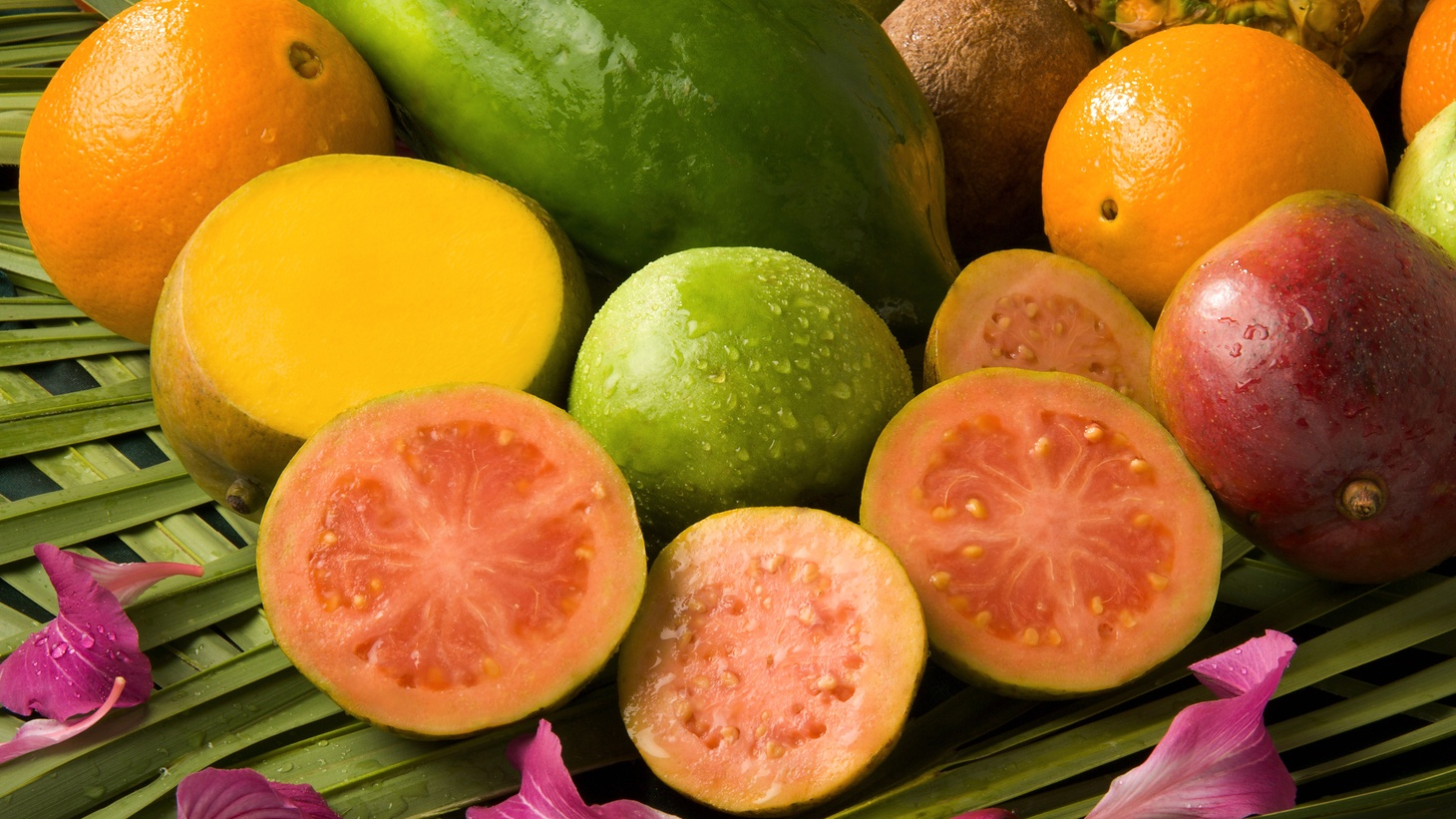 Guava, the juicy, pink, sliced fruit in the center, is high in antioxidants.