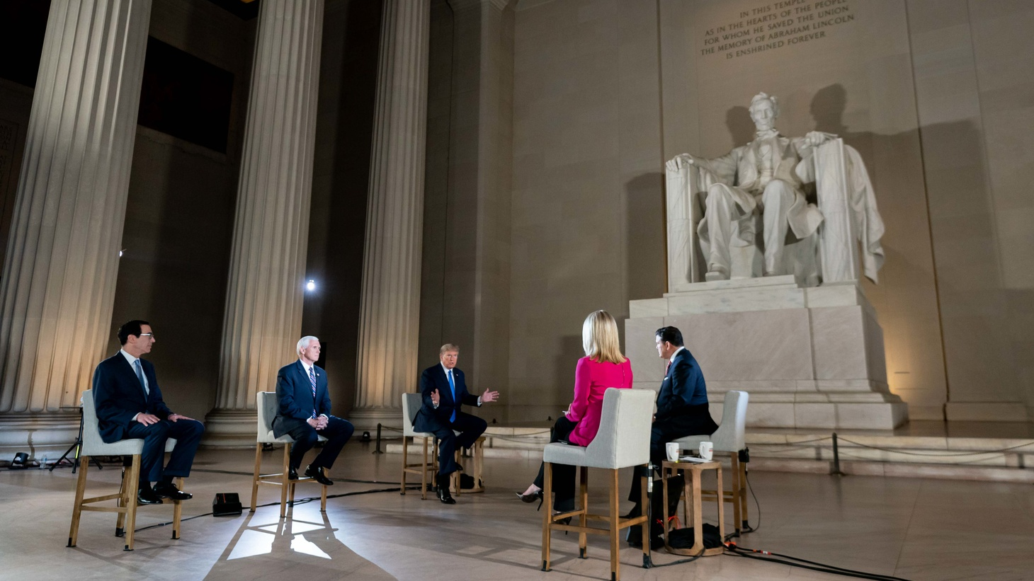 President Donald Trump, joined by Vice President Mike Pence and Treasury Secretary Steven Mnuchin participated in a Fox News virtual town hall from the Lincoln Memorial on May 3, 2020. Trump and Fox News had been fast friends, but lately the President has attacked the network.