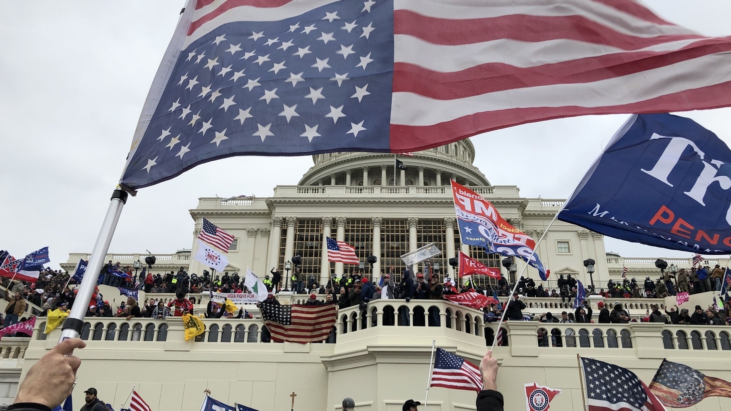 Rioters stand on the U.S. Capitol building to protest the official election of President-elect Joe Biden on Jan. 6, 2021 in Washington DC.