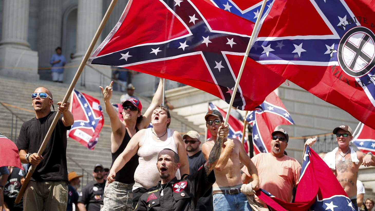 "Alt-right members preparing to enter Emancipation Park holding Nazi, Confederate, and Gadsden ""Don't Tread on Me"" flags, August 2017."