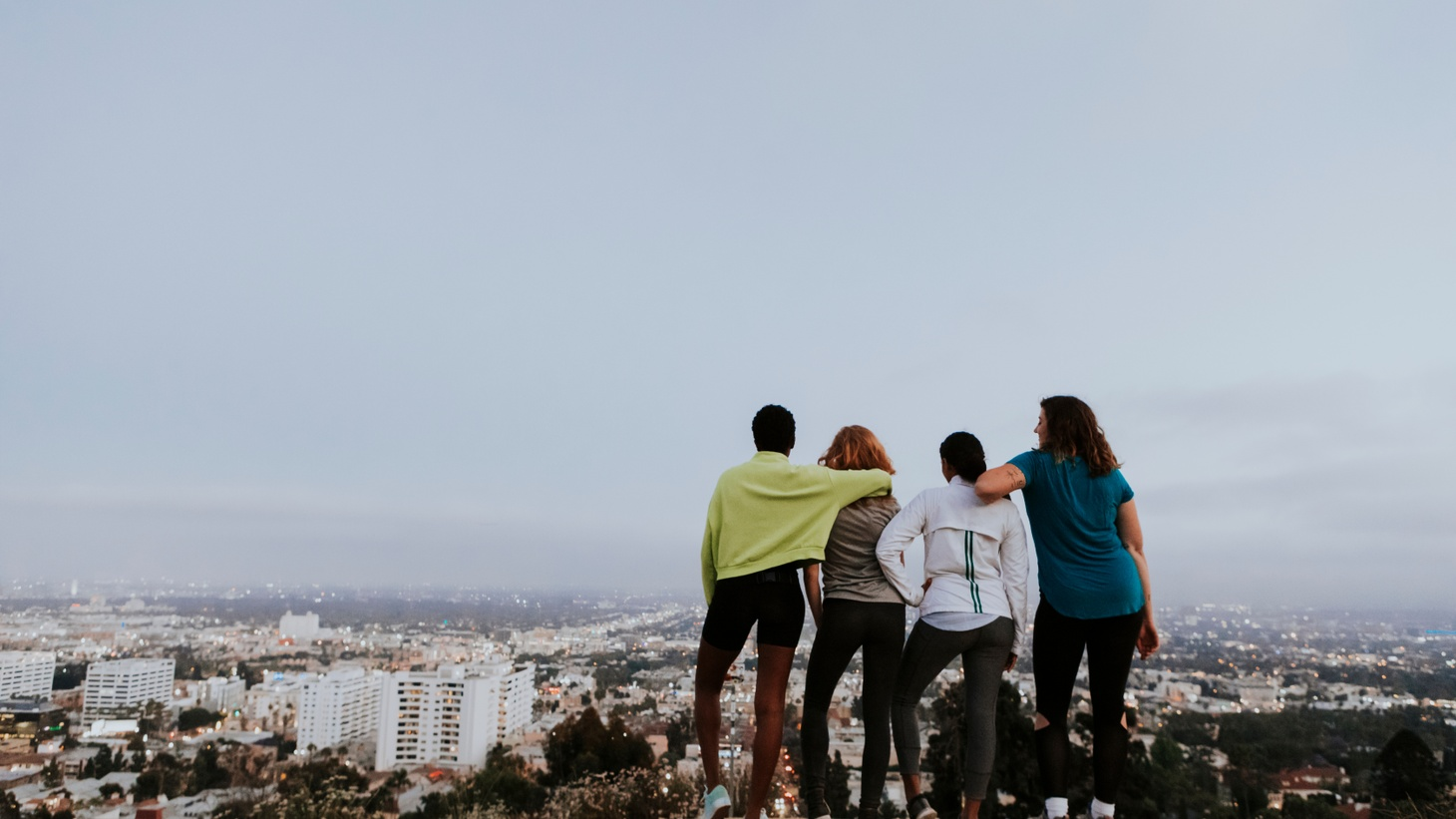 Friends on a hike overlooking Los Angeles.