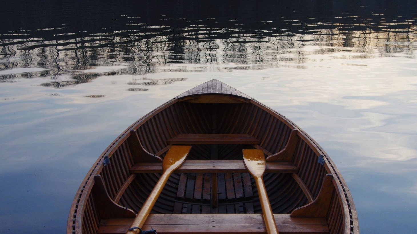 Boat on calm water.