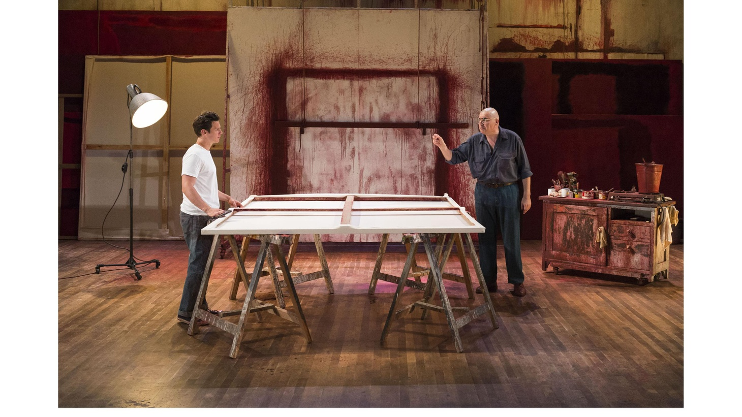"At the heart of the play ""Red"", two men stand before a massive canvas. It's center stage in Mark Rothko's cavernous studio.  The blank expanse towers before the artist and his young assistant. As the young man pours thick red paint into two galvanized buckets, Rothko, played by Alfred Molina, drops the needle on TLU."