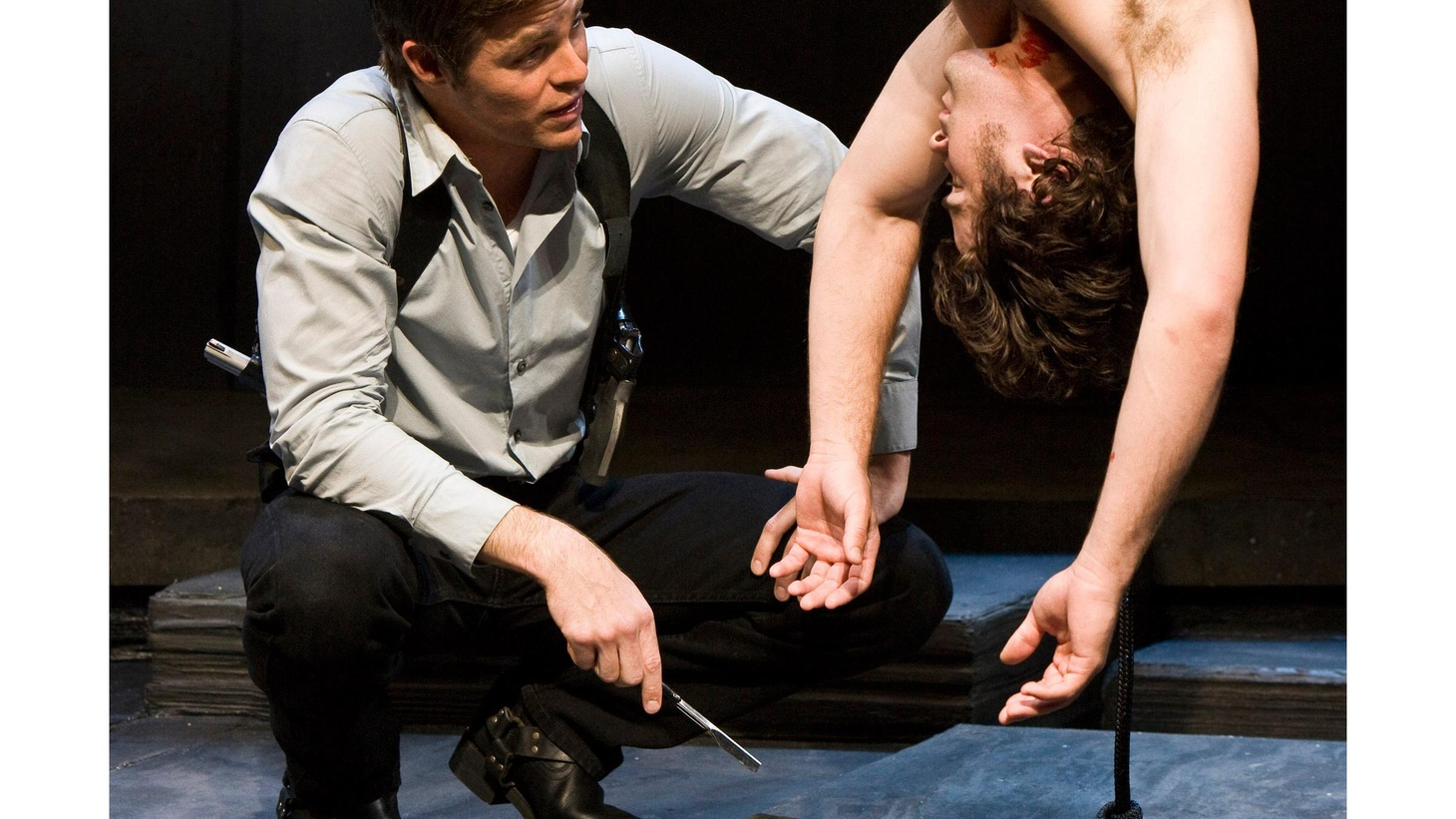 It's about two thirds of the way through Martin McDonagh's play The Lieutenant of Inishmore, and the stage is covered in blood. Not just a bit of blood - but literally gallons of blood. And not just blood. There's a severed head. And a torso...