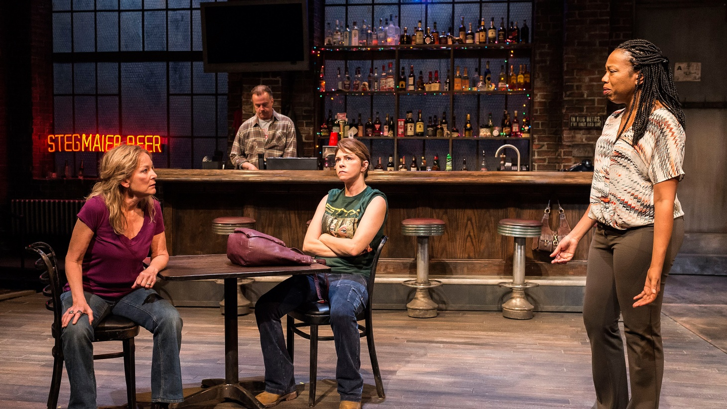 """It's easy to see why Lynn Nottage's play """"Sweat"""" won a Pulitzer prize. """"Sweat"""" chronicles what happens to a union factory town when the old way of doing things isn't doing it anymore. It's set mostly in a local dive bar."""